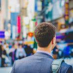 man in suit in busy street